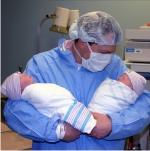 Dad with newborn twins