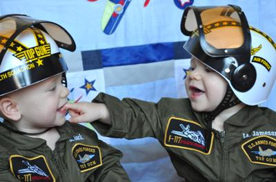 This is a photo of my sons wearing their Halloween costumes while playing in their room.  Air Force sons, and future pilots!