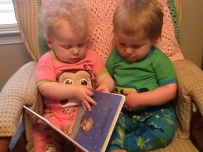 Grace & Griffin reading a bedtime story together.