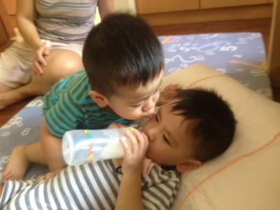 Joash giving his twin brother Nathan an impromptu kiss