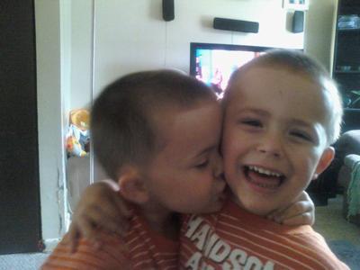 Dylan giving Austin a kiss