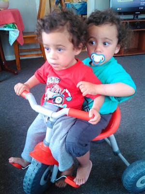 Niu and Vili Malae 'sharing' the bike