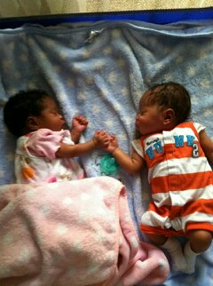 Joshua and Juliana holding hands while they sleep