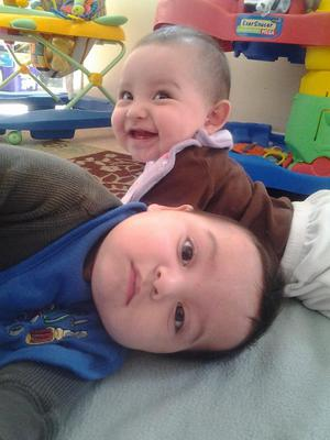 Our b/g twins at 6 months! Our boy looks very happy to be in the picture, while little miss is Sunshine as always lol!