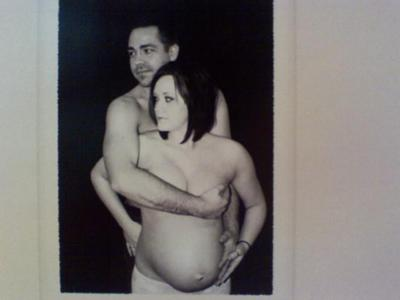 My husband and I, 24 weeks pregnant with boys number 2 and 3!