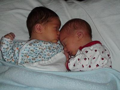 Kye letting his baby sis rest on him!