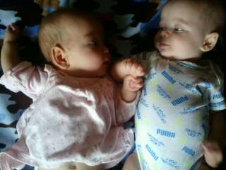 Colton holding Gracelynn's hand to help her go to sleep